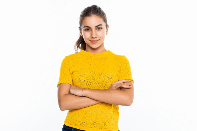 beautiful-teen-girl-student-with-confident-expression-keeps-arms-folded-portrait-smiling-teenager-isolated-white-wall (1)